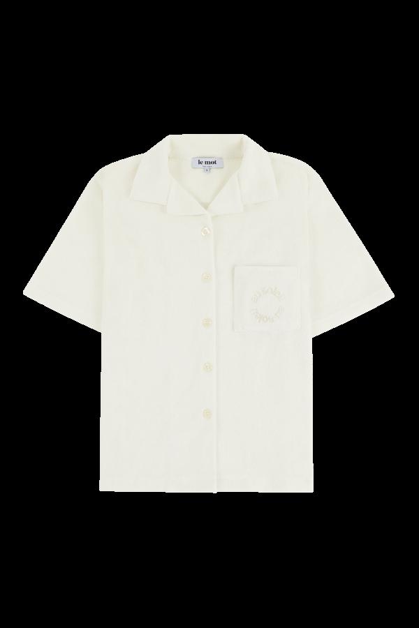 Camisa off-white em algodão turco com bordado 'au soleil' ton-sur-ton, €80
